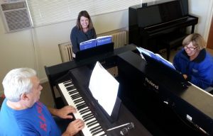 Adult piano lessons in a group setting